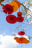 Umbrella paper hung on the tree Royalty Free Stock Photos