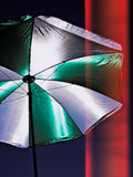 Umbrella on  Patio with red wall background. Conceptual image expressing the idea of protection, safety with red curtain background Royalty Free Stock Photo