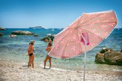 The Umbrella on a pebble beach Royalty Free Stock Images