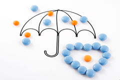 Umbrella and pills Royalty Free Stock Image