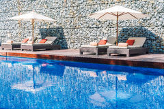 Umbrella pool and chair royalty free stock photo