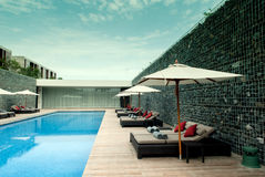 Umbrella pool and chair stock images
