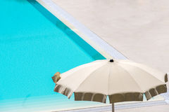 Umbrella pool. White umbrella pool closeup poolside Royalty Free Stock Images