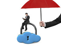 Umbrella protect businessman using tablet on cloud lock. With white background Royalty Free Stock Image