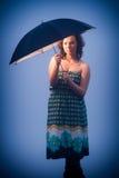 Umbrella protecting young woman Royalty Free Stock Photos