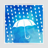 Umbrella and rain drops on the Blue Triangular Polygonal backgro Stock Photos