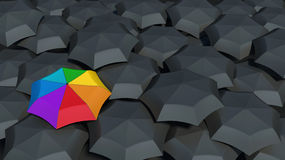 Umbrella with rainbow colors against the black umbrellas Royalty Free Stock Photography