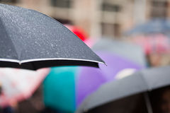 Umbrella with raindrops stock images