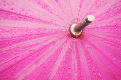 Umbrella with raindrops and vintage filter effect Stock Photos