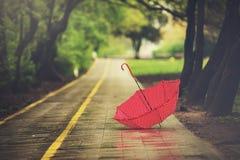 Umbrella on a rainy autumn day Royalty Free Stock Photos