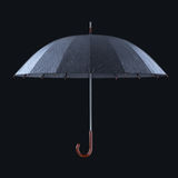 Umbrella with rainy drops isolated on dark studio background. Stock Photography