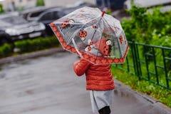 Umbrella red summer yellow boots girl toddler royalty free stock photos