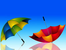 Umbrella and reflection on dark blue background Stock Images