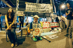Umbrella Revolution in Hong Kong 2014. HONG KONG, OCT 10: Crowd of protesters occupy the road in Admiralty on 10 October 2014. Hong Kong people are fighting for Royalty Free Stock Image