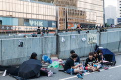 Umbrella Revolution in Hong Kong 2014. HONG KONG, OCT 2: Crowd of protesters occupy the road in Admiralty on 2 October 2014. Hong Kong people are fighting for a stock photography