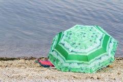 Umbrella on river lake Stock Photography