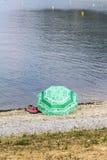 Umbrella on river lake Royalty Free Stock Photography