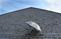 Umbrella and roof. The house is very security Stock Photo