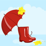 Umbrella and rubber boots Stock Image