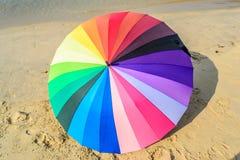 Umbrella and sand blackground Royalty Free Stock Photo