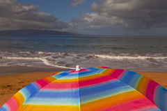 umbrella on a sandy beach Royalty Free Stock Images