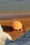 Umbrella on sandy beach Royalty Free Stock Photos