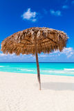 Umbrella on a sandy tropical beach Royalty Free Stock Image