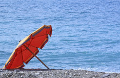 Umbrella on the sea. Summer season is arriving and the first umbrella is already on the beach Stock Image