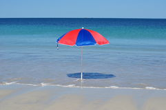 Umbrella on tropical beach in the sun Stock Photography