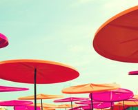 Umbrella Shades. Colorful plastic umbrellas in the beach Royalty Free Stock Photo