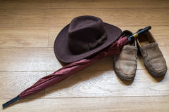 Umbrella, shoes and fedora hat Stock Photography