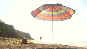 Umbrella on the shore. Beach and sky. Discover your own paradise stock video footage