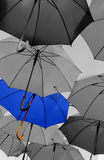 Umbrella standing out from the crowd unique stock photos
