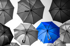 Umbrella standing out from the crowd unique Stock Photo