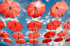Umbrella standing out from the crowd unique Stock Photography