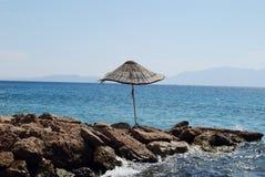 Umbrella on the stone beach. Beach umbrella on the stone, Turkey stock photography