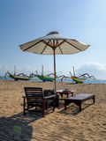 Umbrella and sun chair Stock Photo