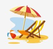 Umbrella and sun lounger on the beach. Royalty Free Stock Photos