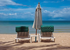 Umbrella and sun loungers Royalty Free Stock Images