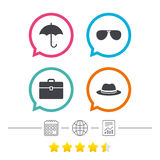 Umbrella, sunglasses and hat with case. Royalty Free Stock Photos