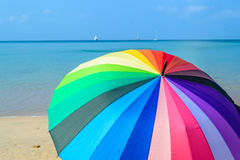 Umbrella in sunny day on the beach Stock Photography