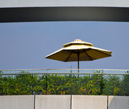 Umbrella on a roof top modern building. Beautiful sunshade umbrella photograph captured from a modern building top stock photography