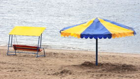 Umbrella and swing on a beach. Umbrella and swing on a deserted river beach stock video footage