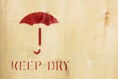 Umbrella symbol on box - Keep Dry Sign Royalty Free Stock Photos