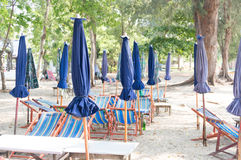 Umbrella and table for dining area on the beach in Thailand Royalty Free Stock Photos