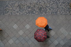 Umbrella talk. At the sidewalk Stock Image