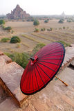 The umbrella with the temple in Bagan, Myanmar.  Royalty Free Stock Photography