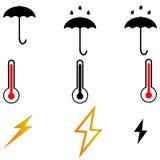 Umbrella thermometr lightnings three items. Stock Photo