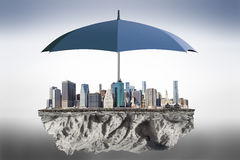 Umbrella to protect the city from the bad weather concept Royalty Free Stock Photography