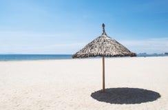 Umbrella on a tropical beach Stock Photos